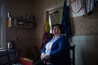 Mama Natalia had her house destroyed by the bombing. Thanks to the solidarity among the inhabitants she found a new home in an old traditional house, but still very close to the front line. Natalia runs an association that provides moral and material support for the people affected by the consequences of the war and visits the wounded in hospital every day. Donetsk, Ukraine, January 04, 2020.