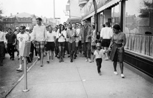 A trial run for the March on Washington for Jobs and Freedom at the Newport Folk Festival 1963. The Newport Folk Festival was July 26-28 and the March on Washington was August 28, 1963. Joan Baez & Cordell Reagon, leader of the Freedom Singers, lead the march through the town of Newport and then gave speeches in Touro Park. © Jim Marshall Photography LLC