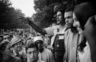 Speaking in Touro Park, Newport RI James Forman, Executive Secretary of SNCC, Cordell Reagon leader of the Freedom Singers & Joan Baez rallying support for the March on Washington the next month August 28, 1963. © Jim Marshall Photography LLC