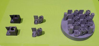 Linsenhalter im Laser-Drucker - Gewichtsreduktion 65 % (Quelle: Leichtbauwelt | ck)
