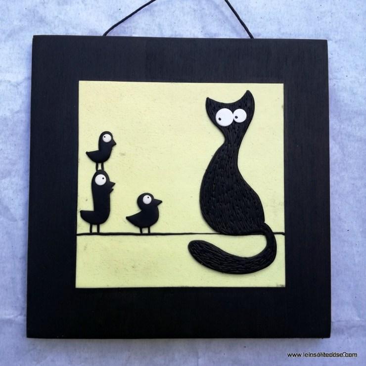 gatti neri stilizzati e uccellini