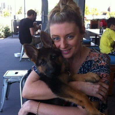 german-shepherd-puppy-getting-cuddles-from-mum