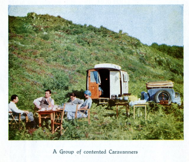 a group of contented caravanners from the 1920s