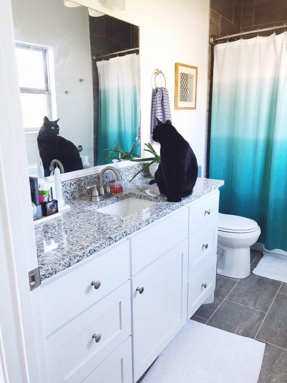 white bathroom with gray tiles
