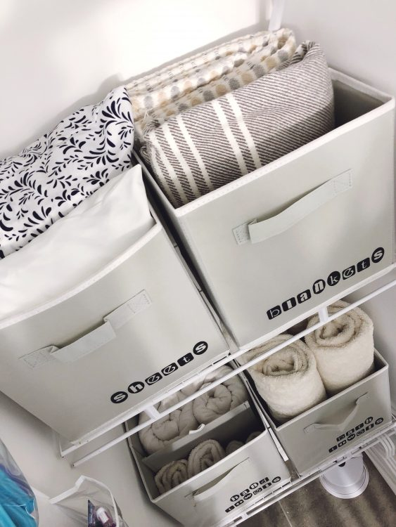 small linen closet organization with bins