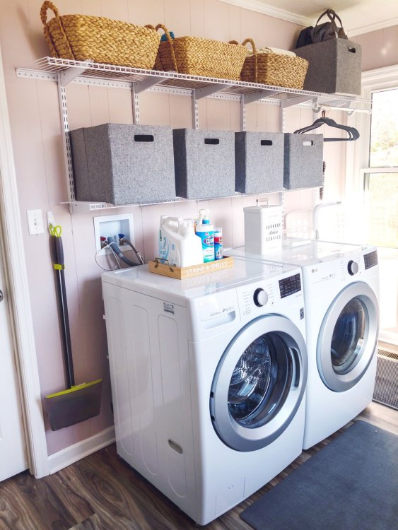 small pink laundry room by Lela Burris