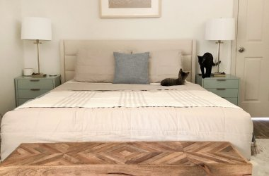 neutral bedroom with kittens