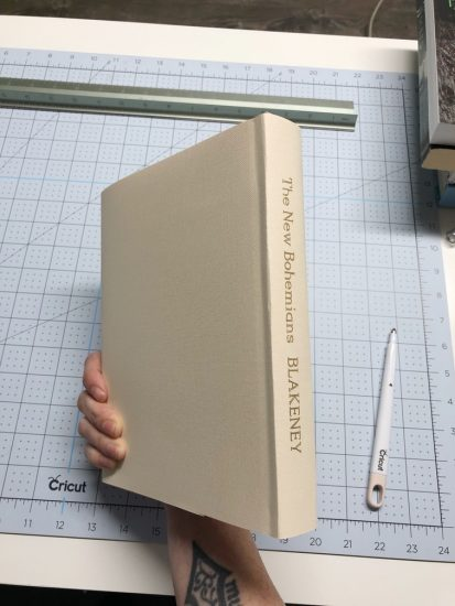 completed cricut book cover with gold foil