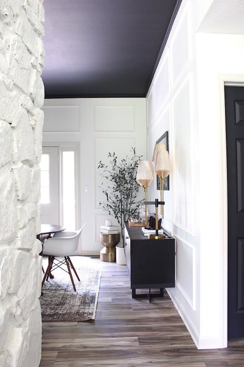 black ceiling in white dining room