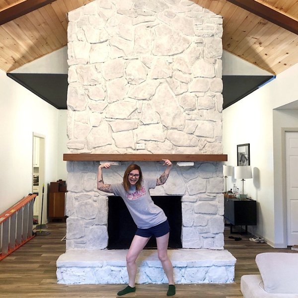 stone fireplace with faux whitewash