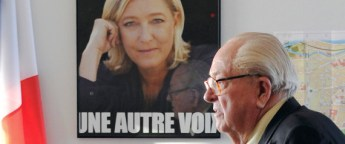 """(FILES) A file picture taken January 12, 2014 shows Front national honorary president Jean-Marie Le Pen walking next to a campaign poster of his daughter, the president of the party Marine Le Pen in Agen, before a press conference. The founder of France's far-right National Front party, Jean-Marie Le Pen, reiterated his assertion on April 2, 2015 that Nazi gas chambers were a """"detail"""" of World War II, prompting condemnation from rights groups and his daughter.  AFP PHOTO / MEHDI FEDOUACH"""