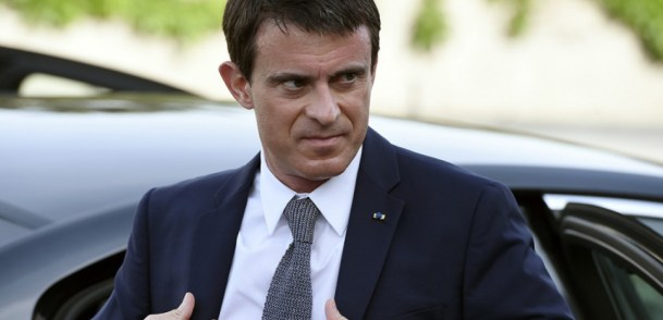"""(FILES) A  picture taken on May 11, 2015 shows French Prime Minister Manuel Valls arriving to inaugurate a new wing of a state research laboratory at the Inserm (Medical Research Institute, Institut national de la sante et de la recherche medicale) in the eastern French city of Lyon. Claude Bartolone, PS President of the National Assembly, said on June 10, 2015, that Manuel Valls had """"been right"""" to make his controversial trip to Berlin to attend the final of the Champions League, as this could support the Paris bid for the Olympics. AFP PHOTO / PHILIPPE DESMAZES"""