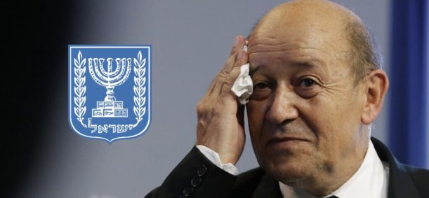 France's Defence Minister Jean-Yves Le Drian wipes his face as he attends a news conference in Paris October 3, 2013. France's military will cut about 7,800 jobs next year, Defence Minister Jean-Yves Le Drian said on Thursday, detailing government belt-tightening plans that the far-right hopes will deliver it votes at municipal elections in 2014.   REUTERS/Gonzalo Fuentes (FRANCE - Tags: POLITICS MILITARY) - RTR3FK4S