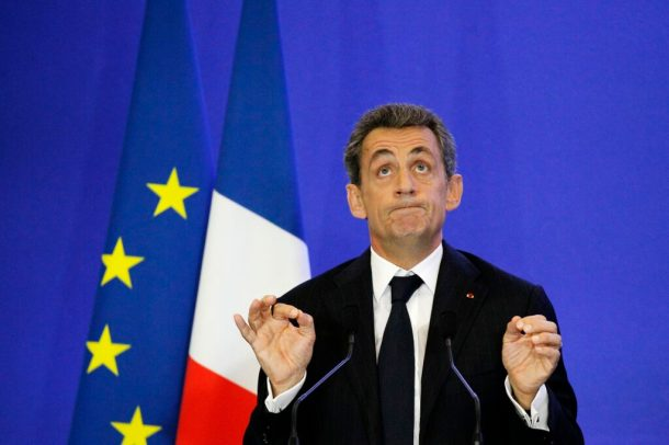 Former French President and leader of the French right-wing Les Republicains party Nicolas Sarkozy gestures as he delivers a speech on November 3, 2015, at the party headquarters, in Paris. AFP PHOTO / MATTHIEU ALEXANDRE