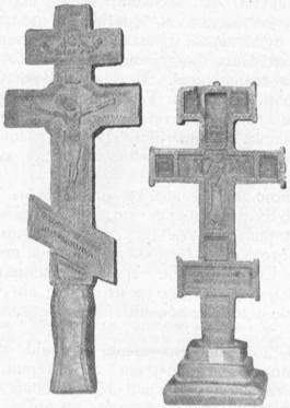 Старі, деревляні, церковні хрести: а Жогатин; б Пелля