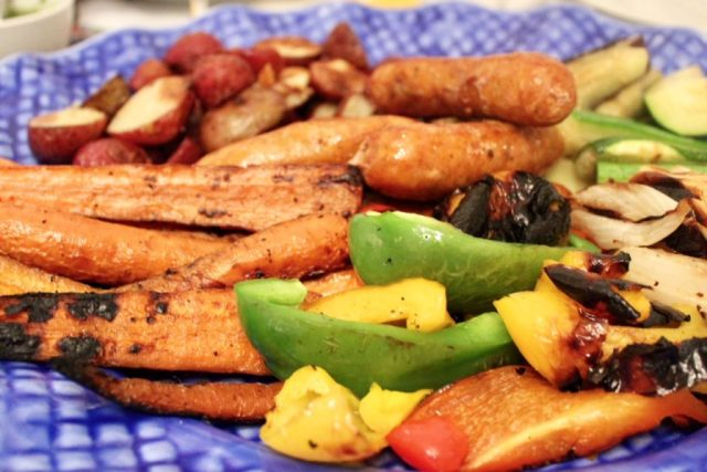 Platter of grilled vegetables and sausages