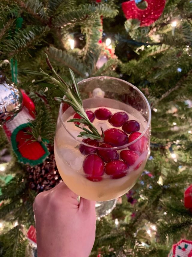 cocktail next to Christmas tree