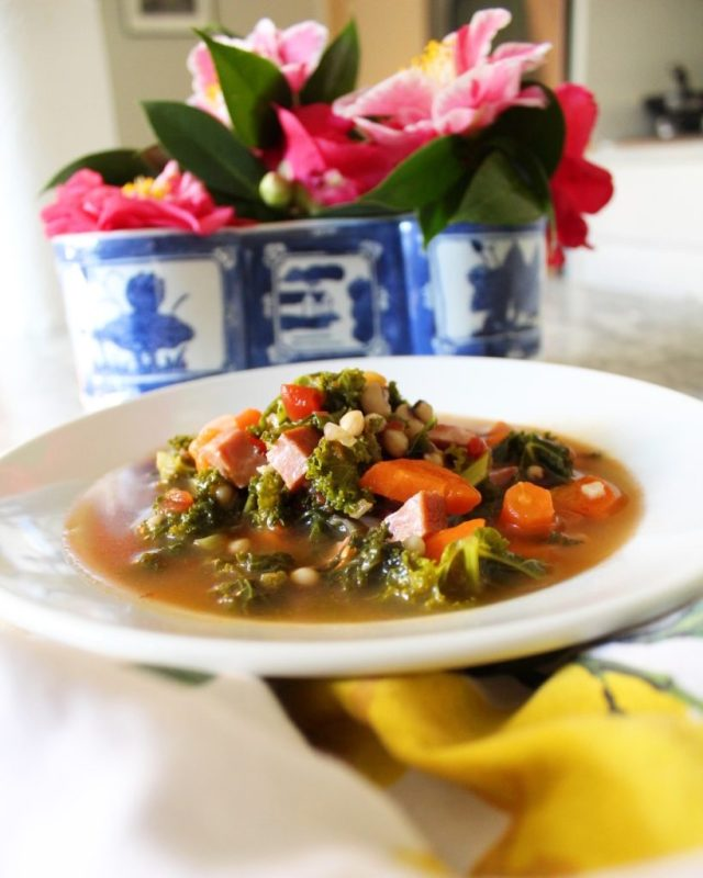 bowl of soup with flowers in the background
