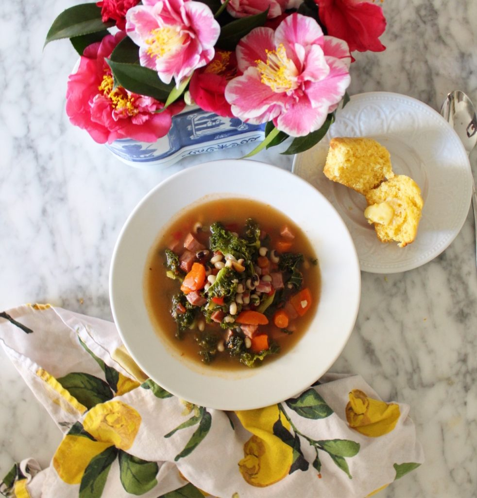 flatly of soup, corn muffin, and flowers