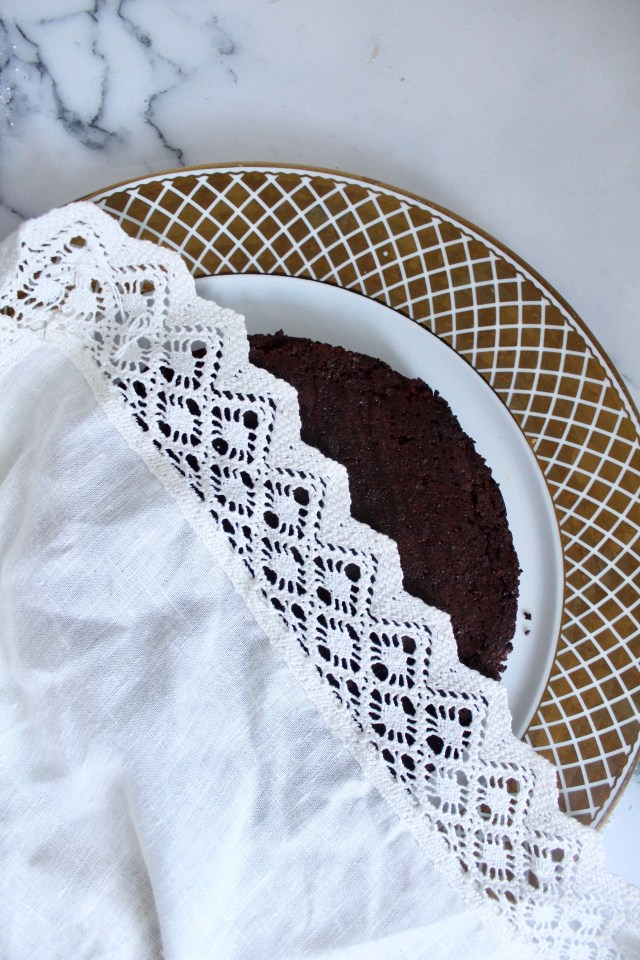 lace on flourless chocolate cake as stencil