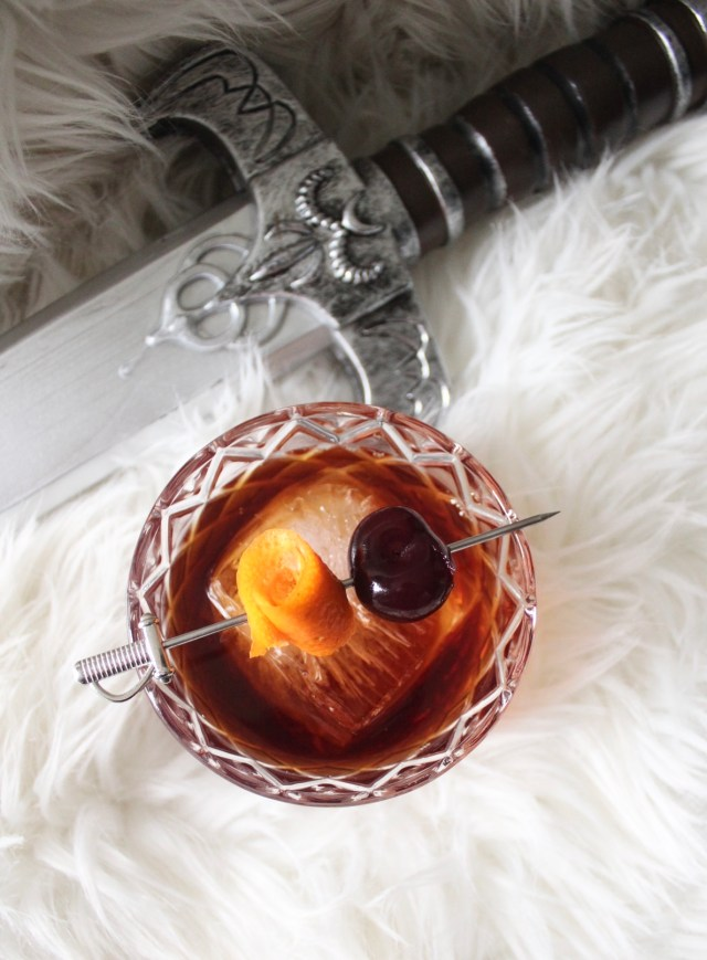 manhattan cocktail with sword and white fur