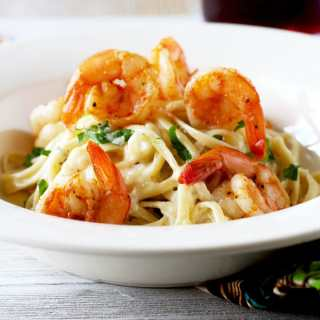 This Cajun Shrimp Alfredo Pasta is creamy, rich and flavorful with a bit of a kick! The best part is, with this shrimp Alfredo recipe, you can have dinner on the table in under 30 minutes!!! Now, that is my kind of meal.