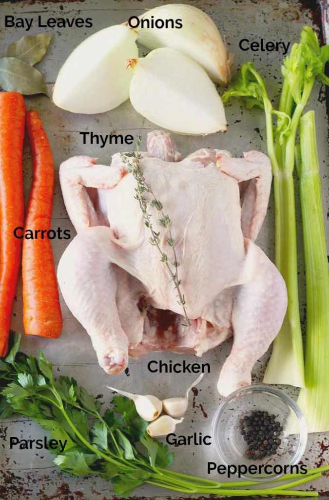 Ingredients to make chicken stock on a tray