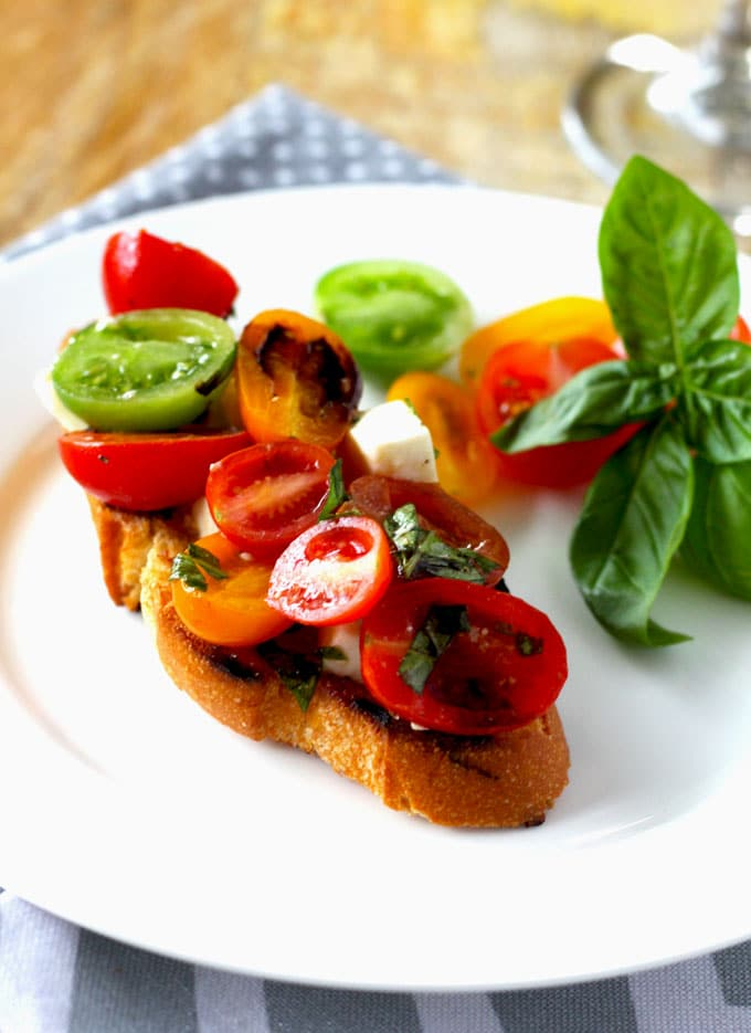 Tomato, Mozzarella and Basil Crostini with Balsamic Reduction, is the perfect for entertaining. Easy to make and sure to impress your guests.