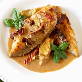 Pan seared to golden perfection, tender chicken with artichokes and sun dried tomato cream sauce is so delicious you will want to drink the sauce with a spoon! This is a one-pan restaurant quality meal!