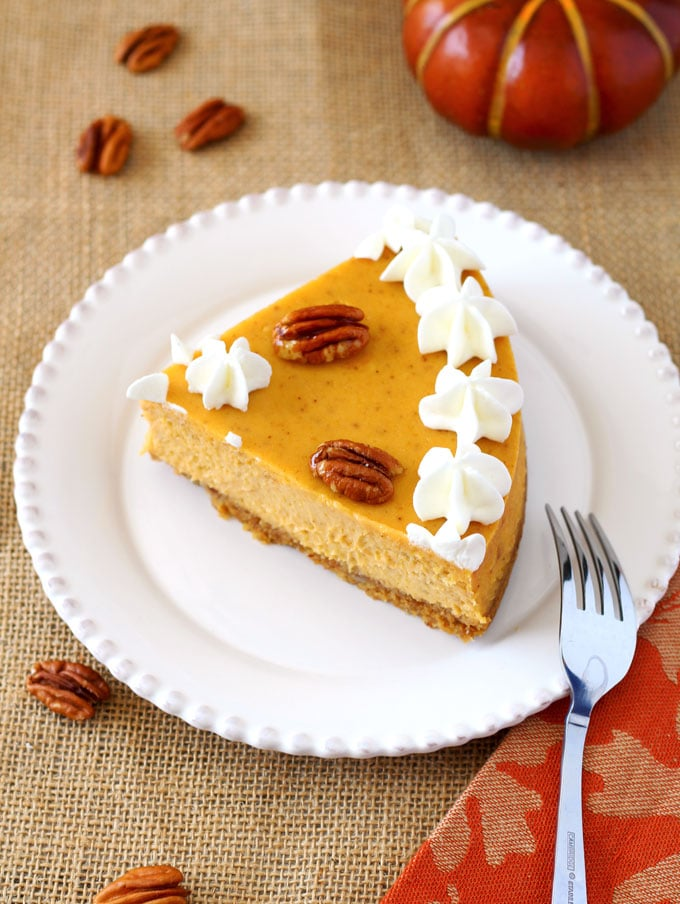 An amazing combination of pumpkin spice and creamy cheesecake with a rich graham cracker and pecan crust this Pumpkin Pecan Cheesecake combines all the fall flavors into one delicious and creamy bite!