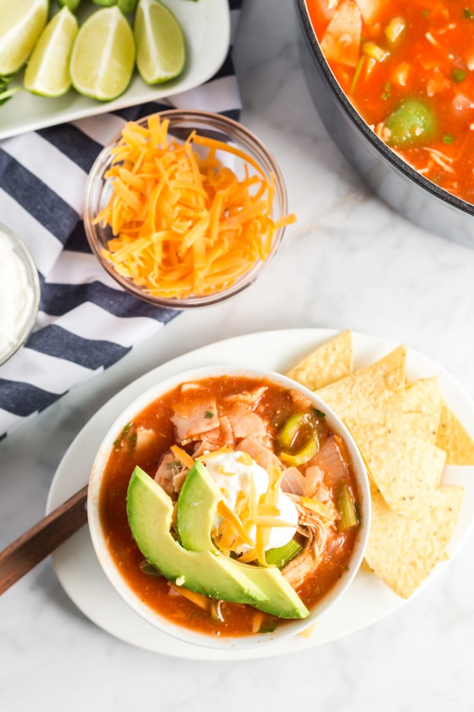 Top view of Mexican soup in a white bowl.