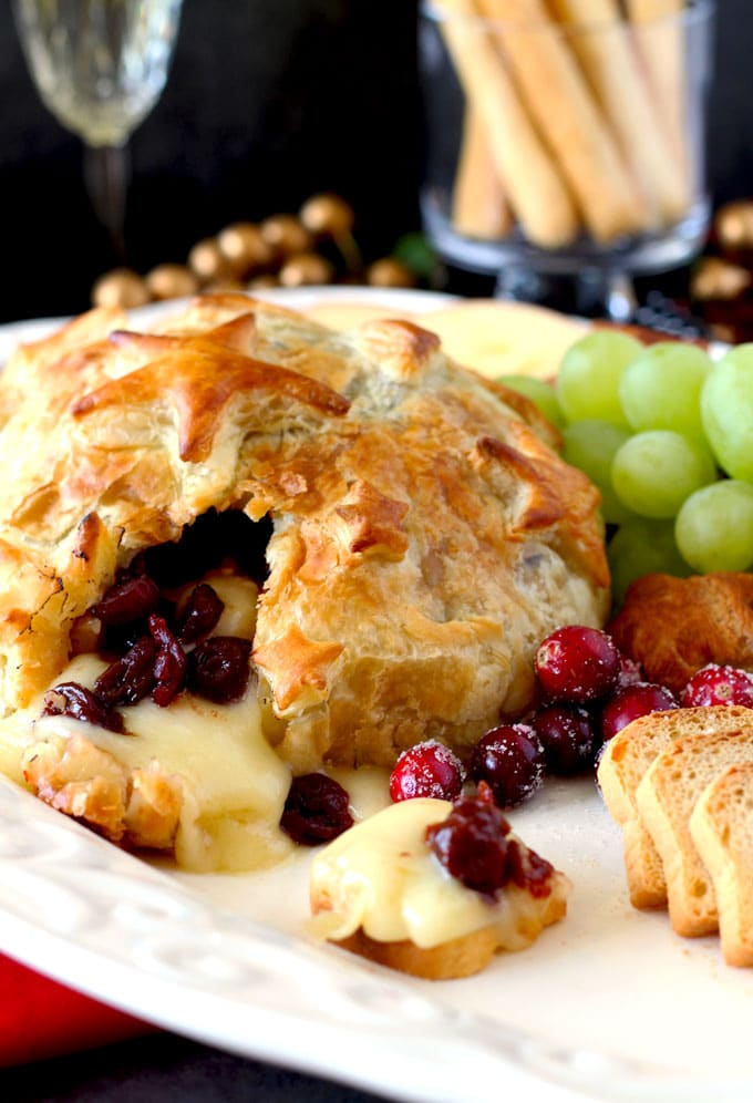 Quick, easy, luxurious and totally scrumptious. This Brie and Cranberries Baked in Puff Pastry is the perfect appetizer for the holiday season!