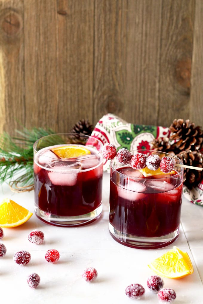The right balance of sweet and tart, with the warmth of bourbon and subtle orange tones. This Cranberry Maple Bourbon Cocktail is bright, delicious, and perfect for the holiday season!