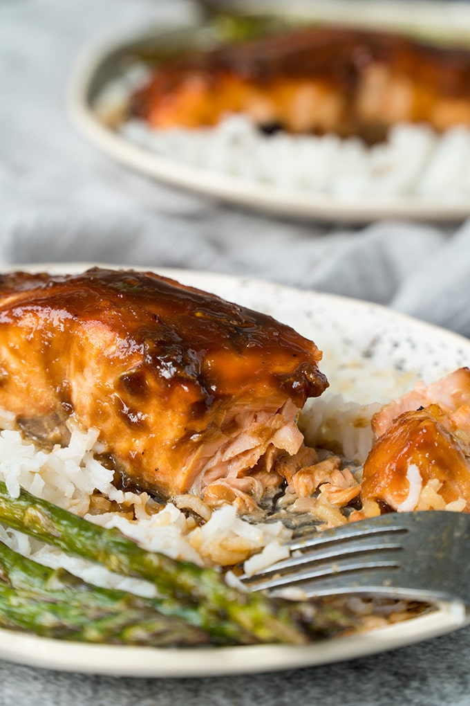 A fillet of miso salmon over rice with asparagus