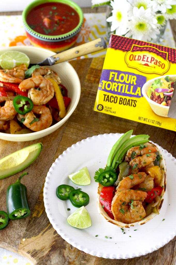 Spiced rubbed and marinated shrimp oven roasted with onions and bell peppers and then smothered in delicious cilantro lime butter. This Sheet Pan Shrimp Fajitas with Cilantro Lime Butter is quick, easy and incredibly flavorful!
