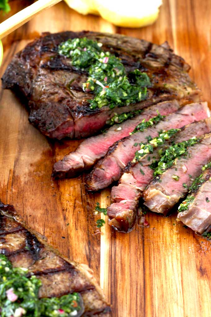 Perfectly grilled Rib-Eye Steaks with the most delicious, flavorful, simple and healthy Chimichurri Sauce. Grilling a steak only takes a few minutes and the sauce can be done in less than 10 minutes! A win-win anytime!!