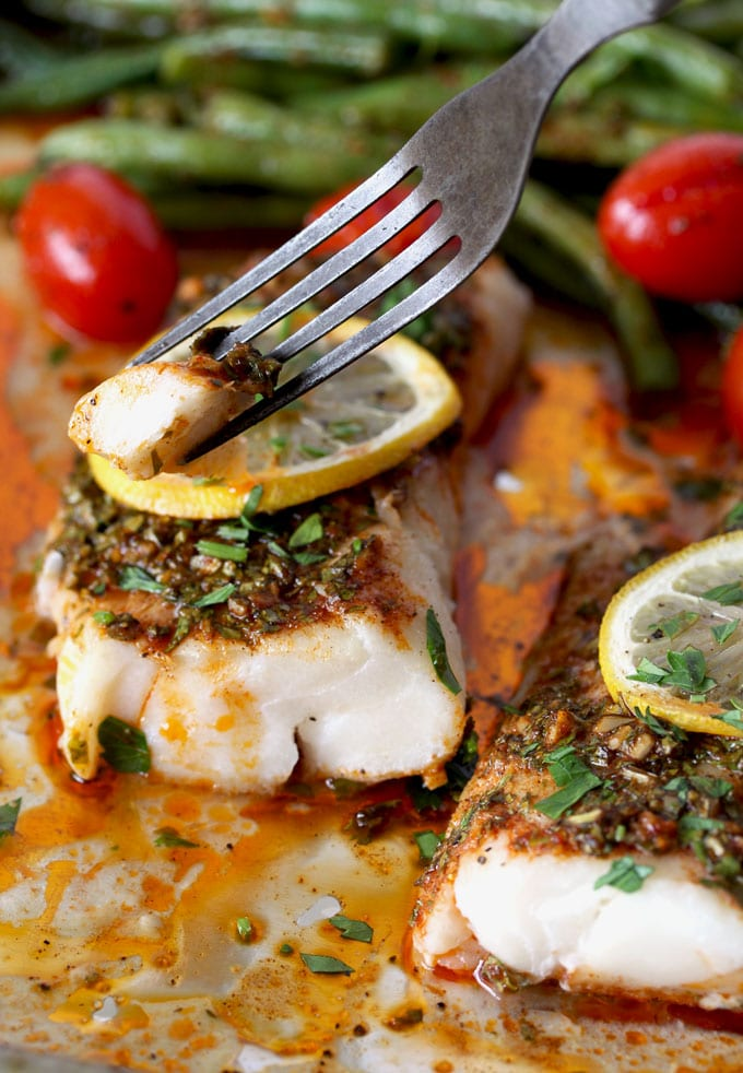 This flavor-packed meal is cooked on a single sheet pan and ready in under 30 minutes! Wild Cod, Green Beans and Cherry Tomatoes are roasted to perfection with Chermoula, a Moroccan inspired fresh herbs, lemon and garlic sauce. Quick, easy and delicious!