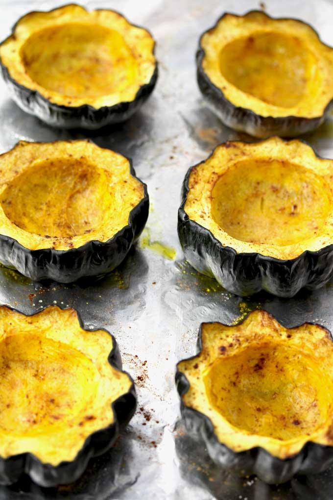 Roasted acorns squashed on a baking sheet.