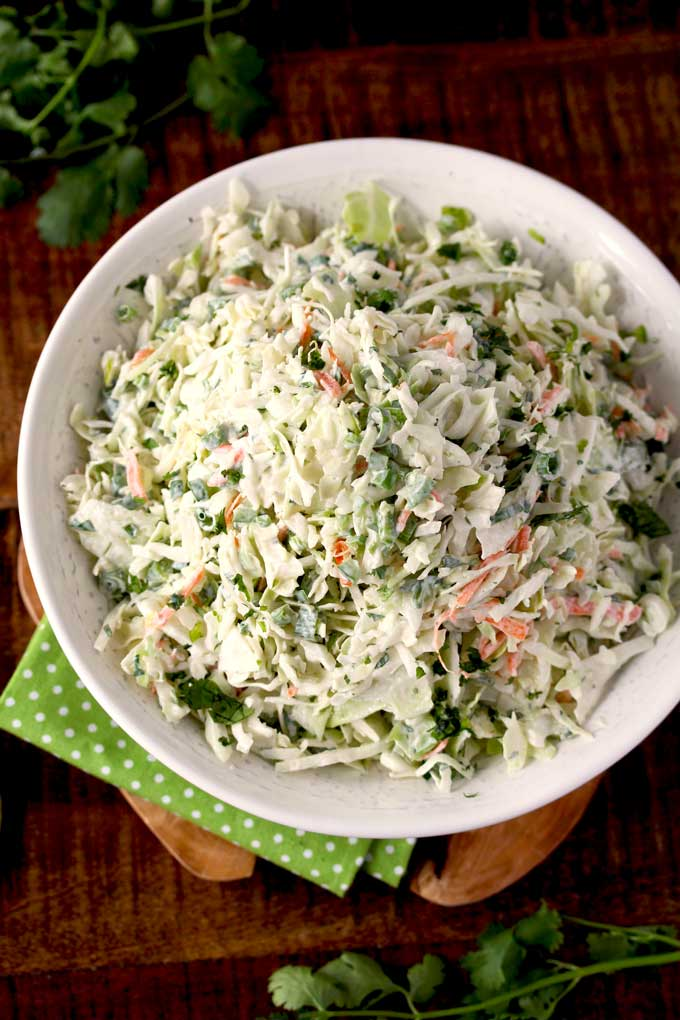 Top view of a white bowl with Cilantro Lime Coleslaw.