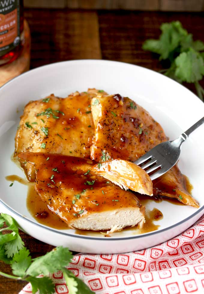 Maple Balsamic Glazed Chicken breast on a white plate