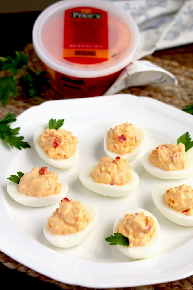 Pimento Cheese Deviled Eggs on a white platter