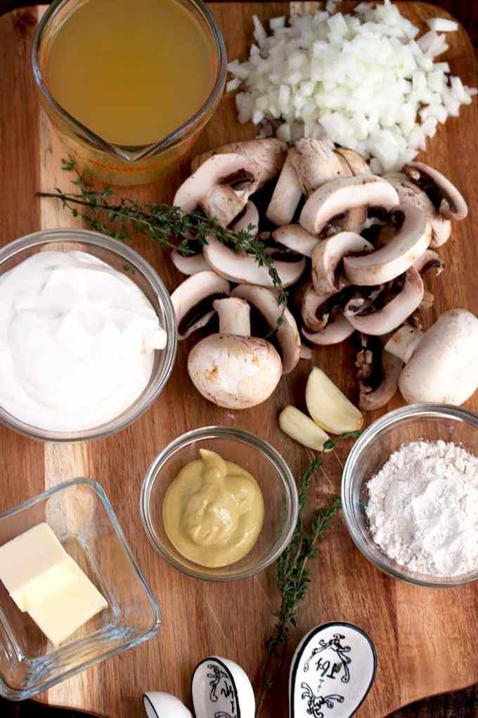 Ingredients to make Chicken Stroganoff on a cutting board.