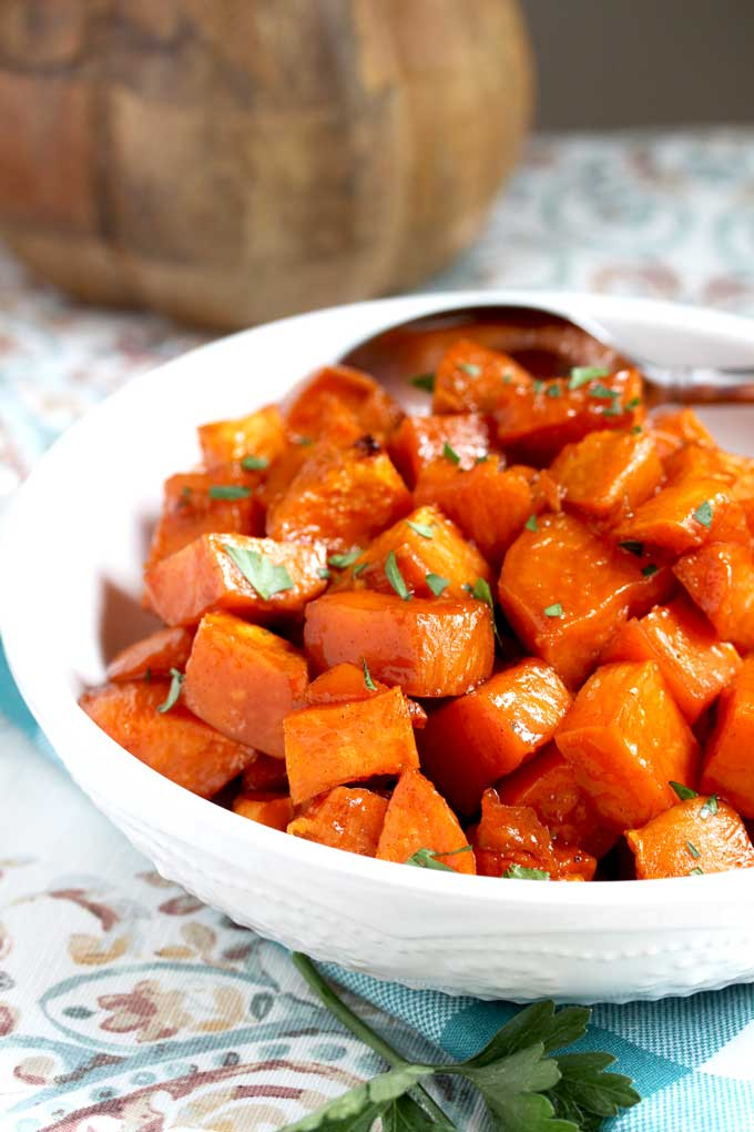 A white bowl filled with Maple Oven Roasted Sweet Potatoes