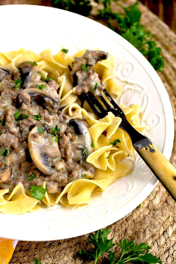 A bowl of egg noodles and creamy stroganoff