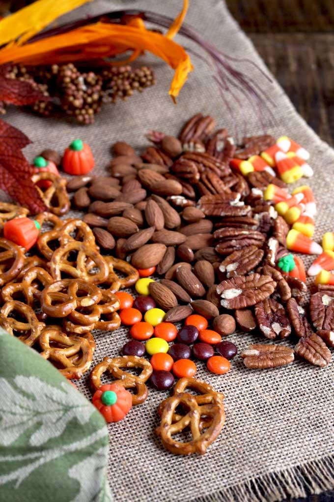 Ingredients to make pumpkin spice snack mix.