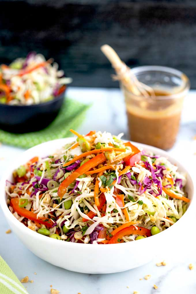 Asian Slaw piled up in a white salad bowl.