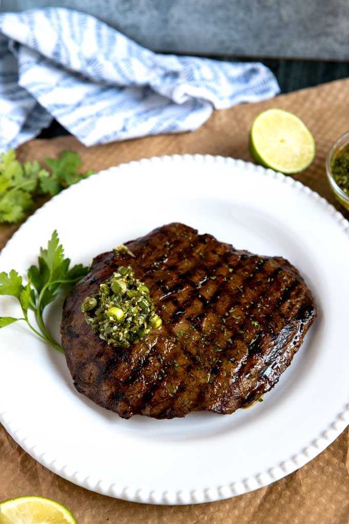 Whole flank steaked grilled and topped with Asian herb sauce.
