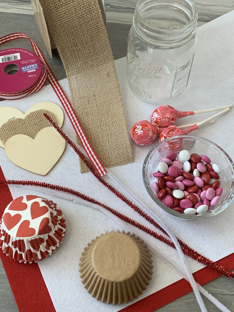 candy, cupcake liners and ribbon for diy valentines mason jar candy bouquet