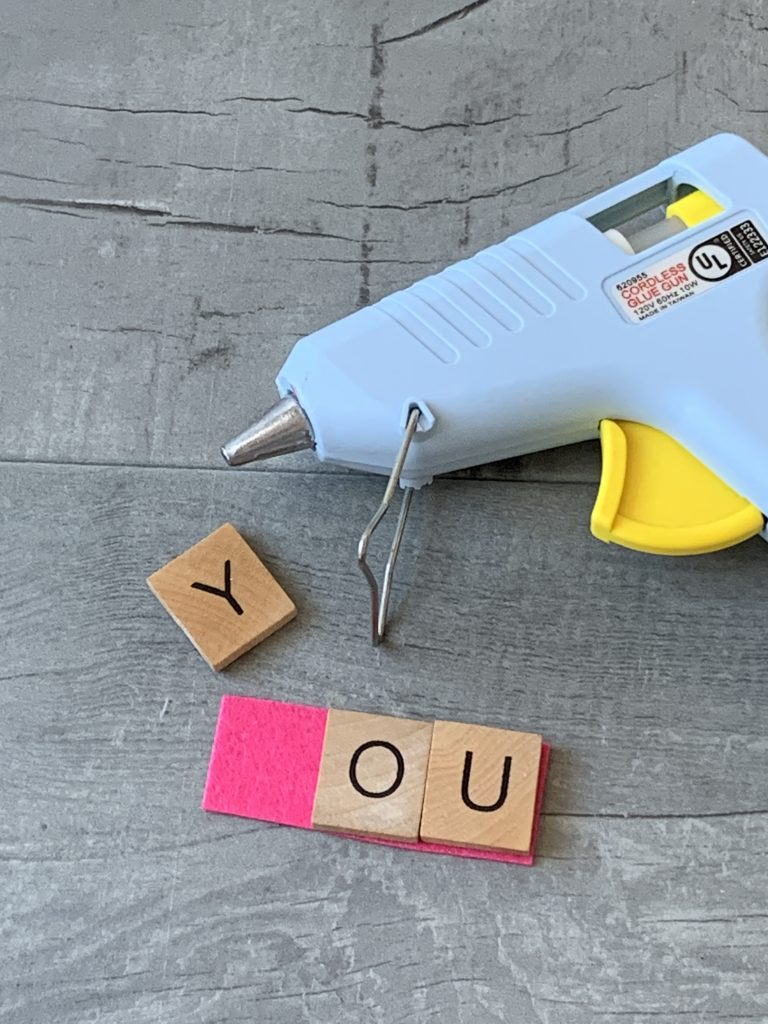 glueing scrabble letters with glue gun on felt