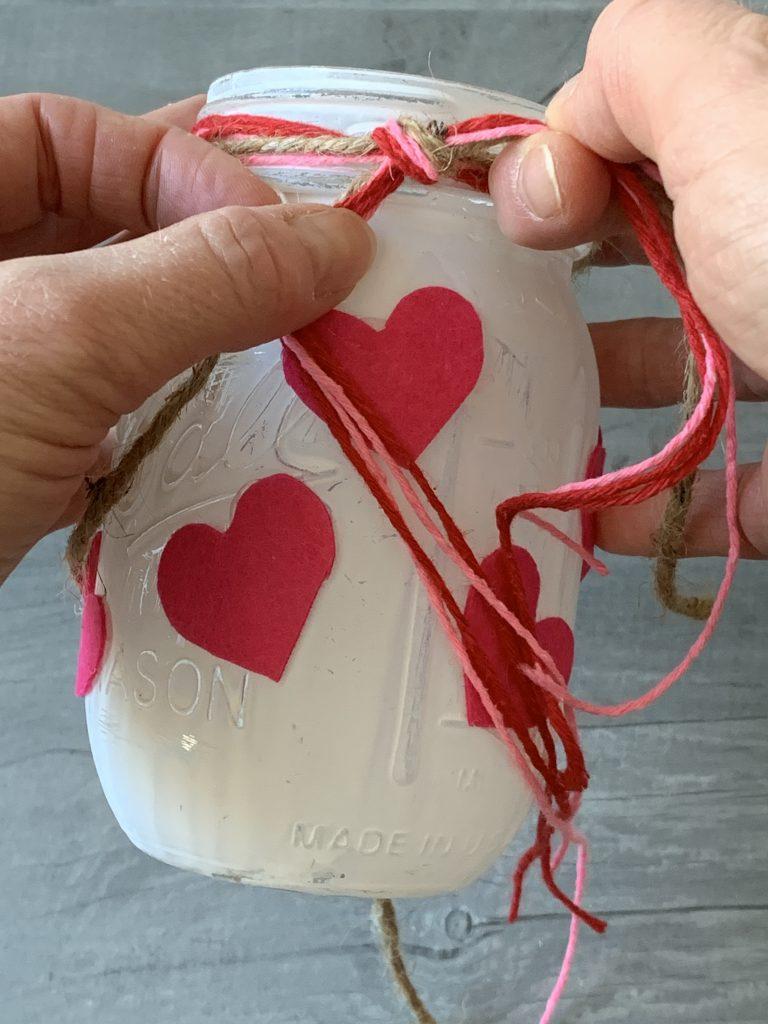tieing knot onto valentines mason jar